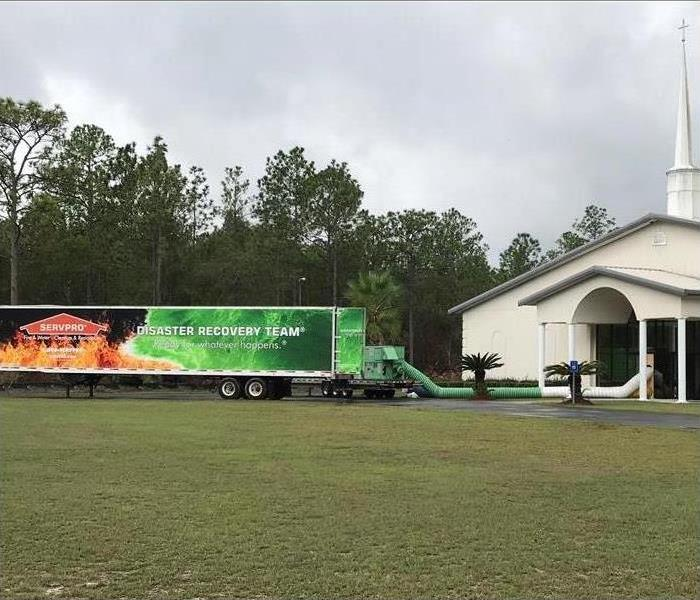 Church with SERVPRO trucks parked outside.